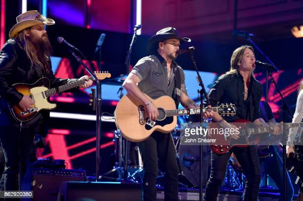 Honorees Chris Stapleton Jason Aldean and Keith Urban perform onstage at the 2017 CMT Artists Of The Year on October 18 2017 in Nashville Tennessee