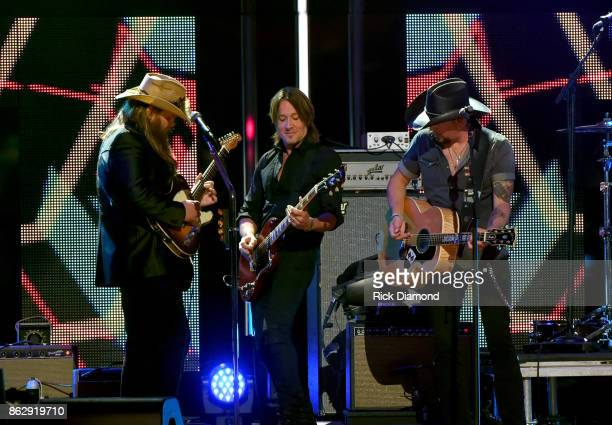 Honorees Chris Stapleton Keith Urban and Jason Aldean perform onstage at the 2017 CMT Artists Of The Year on October 18 2017 in Nashville Tennessee