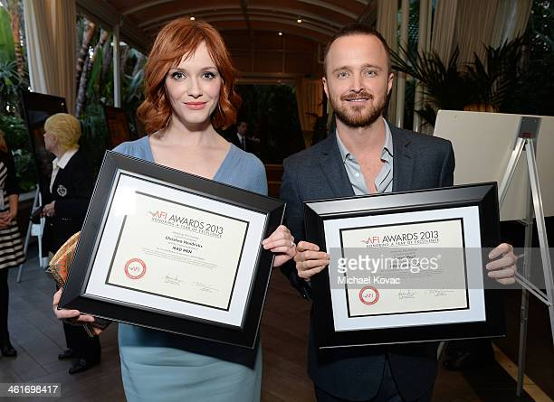 Honorees Christina Hendricks and Aaron Paul attend the 14th annual AFI Awards Luncheon at the Four Seasons Hotel Beverly Hills on January 10 2014 in...