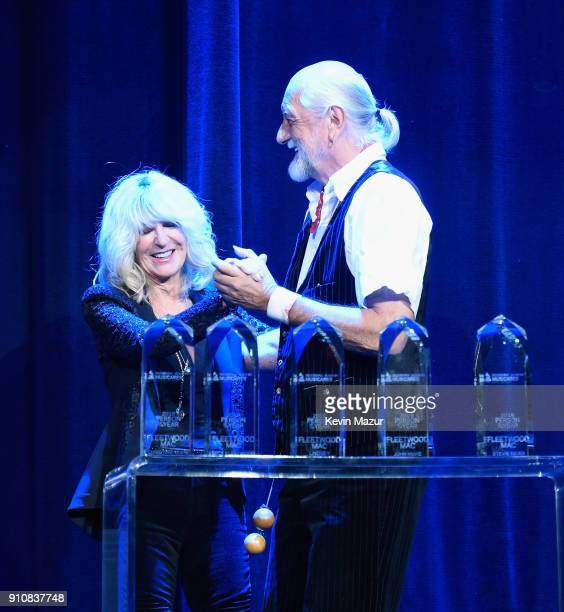Honorees Christine McVie and Mick Fleetwood post onstage during MusiCares Person of the Year honoring Fleetwood Mac at Radio City Music Hall on...