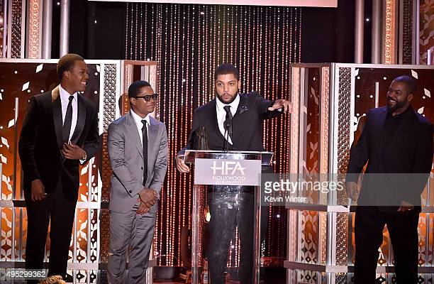 """Honorees Corey Hawkins Jason Mitchell and O'Shea Jackson Jr accept the Hollywood Breakout Ensemble Award for """"Straight Outta Compton"""" from..."""