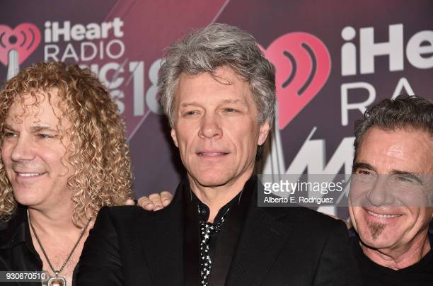 Honorees David Bryan Jon Bon Jovi and Tico Torres of Bon Jovi recipients of the Icon Award pose in the press room during the 2018 iHeartRadio Music...