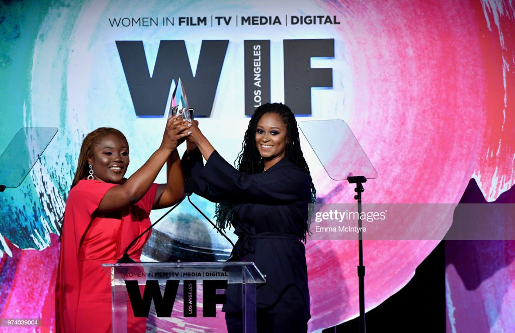 Honorees Denisia 'Blu June' Andrews and Brittany 'Chi' Coney of NOVA Wav accept The Women In Film Artistic Excellence Award onstage during the Women In Film 2018 Crystal + Lucy Awards presented by Max Mara,Lancôme and Lexus at The Beverly Hilton Hotel on June 13, 2018 in Beverly Hills, California.