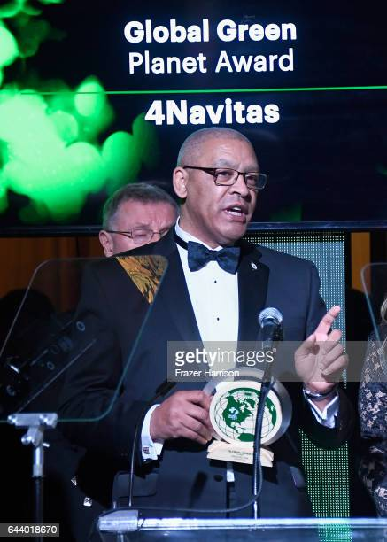 Honorees Doug Hutchieson and Dominic M'Benga and speak onstage during the 14th Annual Global Green Pre Oscar Party at TAO Hollywood on February 22...
