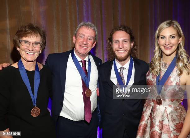 Honoree's Dr Elizabeth Jones Douglas Maclagan Max Frieder and Sarah Cronk pose for a photo on stage at the 2018 Crisis Award at the 2018 World of...