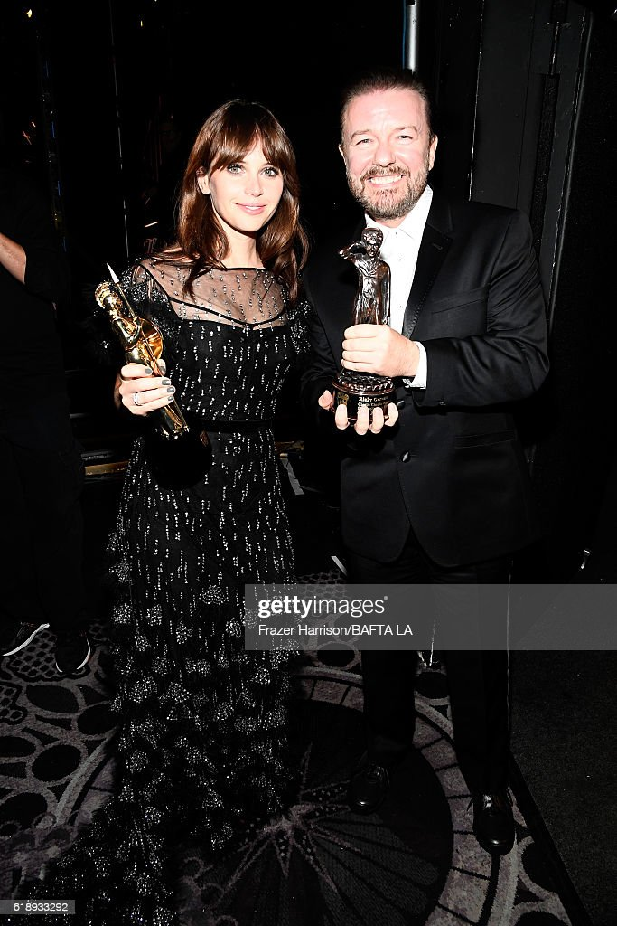 Honorees Felicity Jones (L), recipient of the British Artist of the Year Award Presented by Burberry, and Ricky Gervais, recipient of the Charlie Chaplin Britannia Award for Excellence in Comedy, attend the 2016 AMD British Academy Britannia Awards presented by Jaguar Land Rover and American Airlines at The Beverly Hilton Hotel on October 28, 2016 in Beverly Hills, California.