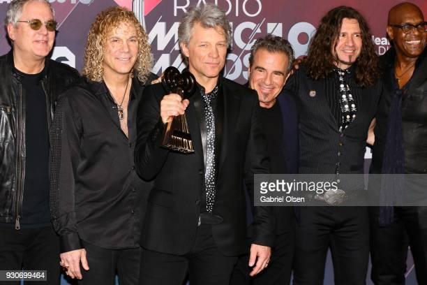 Honorees Hugh McDonald David Bryan Jon Bon Jovi Tico Torres Phil X and Everett Bradley of Bon Jovi recipients of the Icon Award pose in the press...