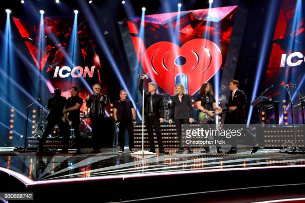 Honorees Hugh McDonald Tico Torres Jon Bon Jovi and David Bryan of Bon Jovi accept the Icon Award perform onstage during the 2018 iHeartRadio Music...