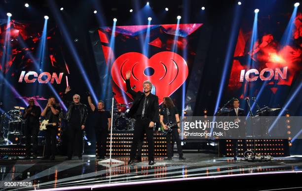 Honorees Hugh McDonald Tico Torres Jon Bon Jovi and David Bryan of Bon Jovi accept the Icon Award perform onstage during the 2018 iHeartRadio Music...