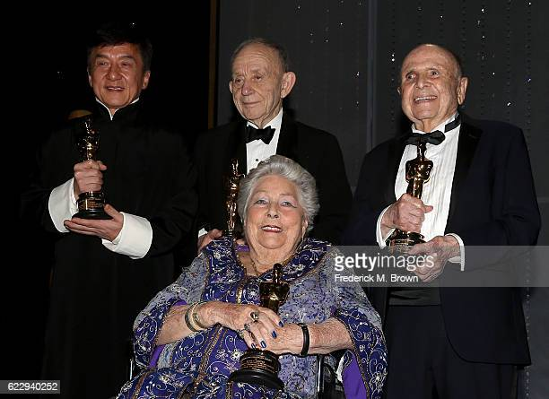 Honorees Jackie Chan Frederick Wiseman Anne V Coates and Lynn Stalmaster pose with their awards during the Academy of Motion Picture Arts and...