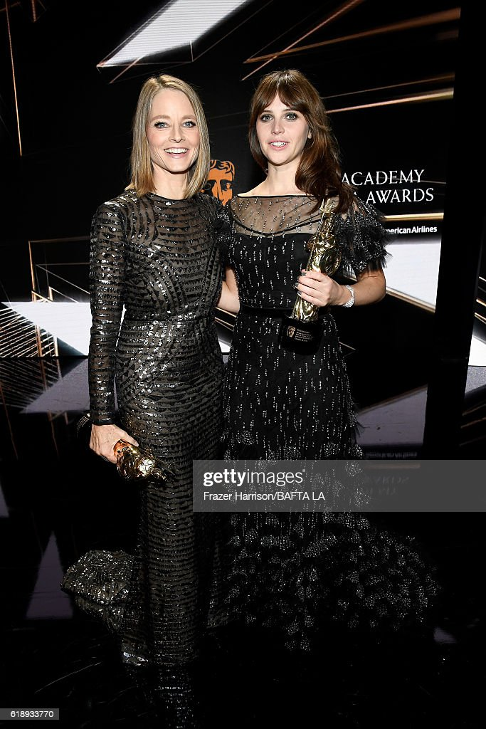 Honorees Jodie Foster (L), recipient of the Stanley Kubrick Britannia Award for Excellence in Film, and Felicity Jones, recipient of the British Artist of the Year Award Presented by Burberry, attend the 2016 AMD British Academy Britannia Awards presented by Jaguar Land Rover and American Airlines at The Beverly Hilton Hotel on October 28, 2016 in Beverly Hills, California.