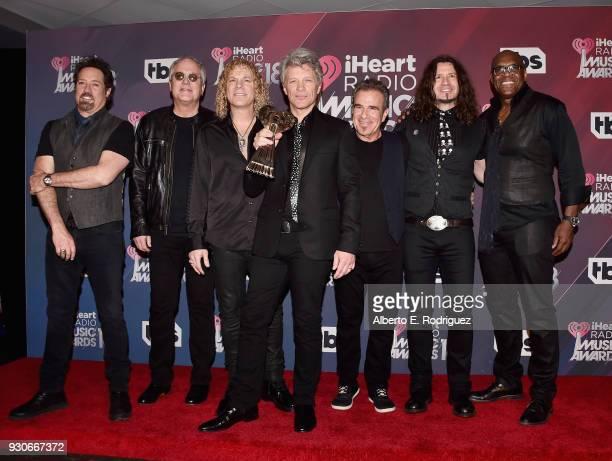 Honorees John Shanks Hugh McDonald David Bryan Jon Bon Jovi Tico Torres Phil X and Everett Bradley of Bon Jovi recipients of the Icon Award pose in...