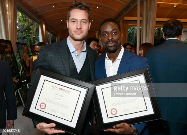 Honorees Justin Hartley and Sterling K Brown pose with awards during 18th Annual AFI Awards at Four Seasons Hotel Los Angeles at Beverly Hills on...
