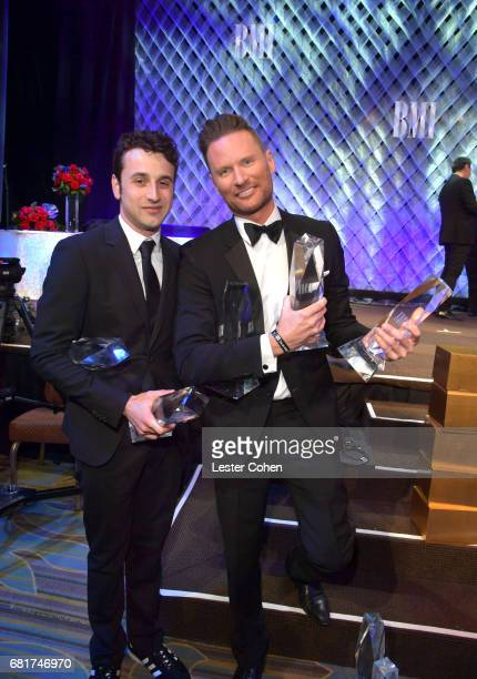 Honorees Justin Hurwitz and Brian Tyler pose with awards during the 2017 Broadcast Music Inc Film TV Visual Media Awards at the Beverly Wilshire...