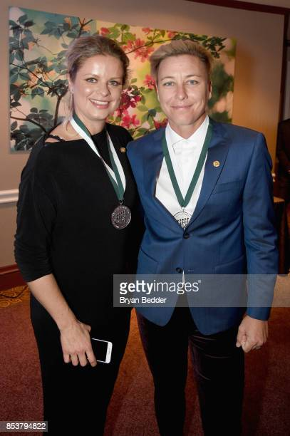 Honorees Kim Clijsters and Abby Wambach attend the 32nd Annual Great Sports Legends Dinner To Benefit The Miami Project/Buoniconti Fund To Cure...