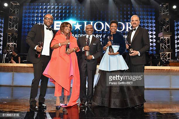 Honoree's Lee Daniels, Patti LaBelle, L.A. Reid, Mellody Hobson, and Eric Holder pose on stage during the BET Honors 2016 Show at Warner Theatre on...