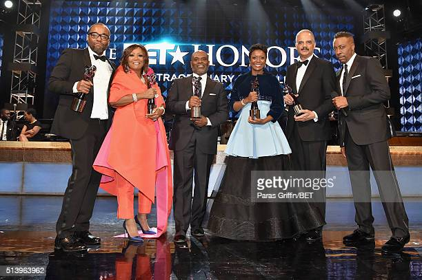 Honoree's Lee Daniels Patti LaBelle LA Reid Mellody Hobson and Eric Holder pose on stage with host Arsenio Hall during the BET Honors 2016 Show at...