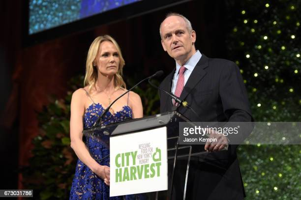 Honorees Lise and Michael Evans accept an award onstage at City Harvest's 23rd Annual Evening Of Practical Magic at Cipriani 42nd Street on April 25...