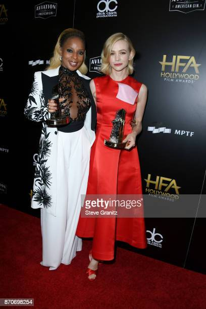 Honorees Mary J Blige and Carey Mulligan recipients of the Hollywood Breakout Ensemble Award for 'Mudbound' pose in the press room during the 21st...