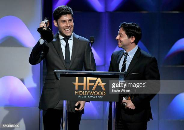 Honorees Michael H Weber and Scott Neustadter accept the Hollywood Screenwriter Award for 'The Disaster Artist' onstage during the 21st Annual...