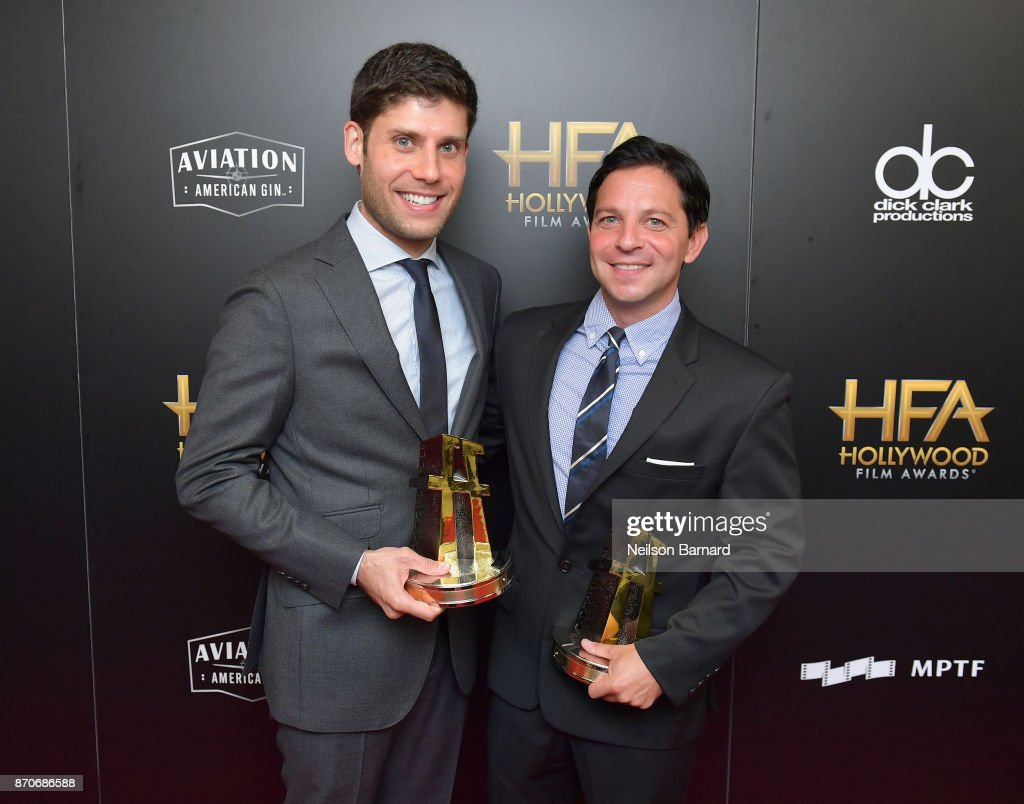 Honorees Michael H. Weber (L) and Scott Neustadter, recipients of the Hollywood Screenwriter Award for 'The Disaster Artist,' pose in the press room during the 21st Annual Hollywood Film Awards at The Beverly Hilton Hotel on November 5, 2017 in Beverly Hills, California.