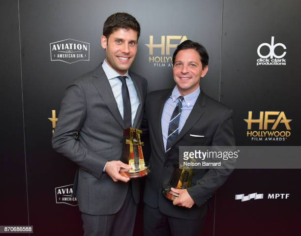 Honorees Michael H Weber and Scott Neustadter recipients of the Hollywood Screenwriter Award for 'The Disaster Artist' pose in the press room during...