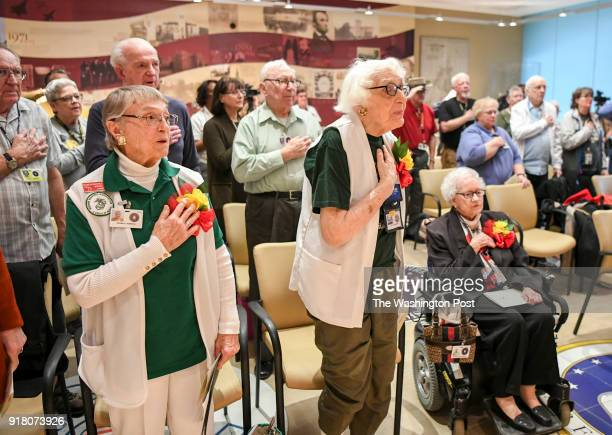 Honorees Norma Rambo Phyllis Bradford and Muriel Kupersmith put their hands over their hearts for the pledge of allegiance during a ceremony honoring...