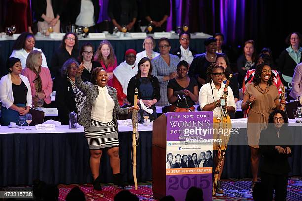 CWB honorees Patrisse Cullors Alicia Garza and Opal Tometi speak onstage during attends The New York Women's Foundation Celebrating Women Breakfast...