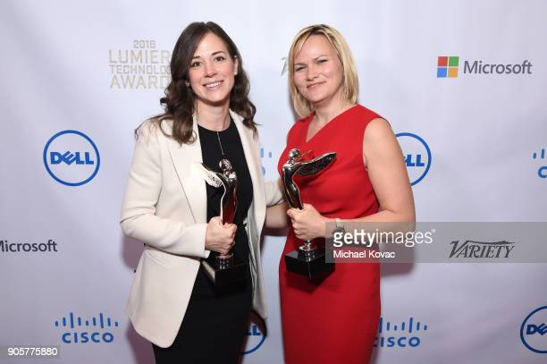 Honorees Poppy Crum and Kathleen Schroeter pose with the Distinguished Leadership Award at the Advanced Imaging Society 2018 Lumiere Technology...