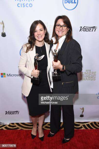 Honorees Poppy Crum and Victoria Alonso pose with the Distinguished Leadership Award at the Advanced Imaging Society 2018 Lumiere Technology Awards...