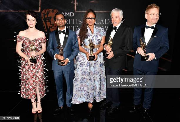 Honorees pose with their awards Claire Foy with Britannia Award for British Artist of the Year presented by Burberry Aziz Ansari with Charlie Chaplin...