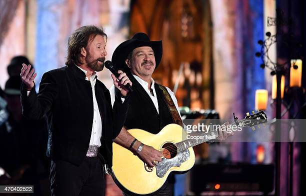 Honorees Ronnie Dunn and Kix Brooks of music group Brooks Dunn accept the 50th Anniversary Milestone Award onstage during the 50th Academy of Country...