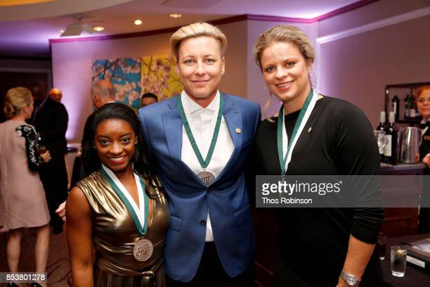 Honorees Simone Biles Abby Wambach and Kim Clijsters attend the 32nd Annual Great Sports Legends Dinner To Benefit The Miami Project/Buoniconti Fund...
