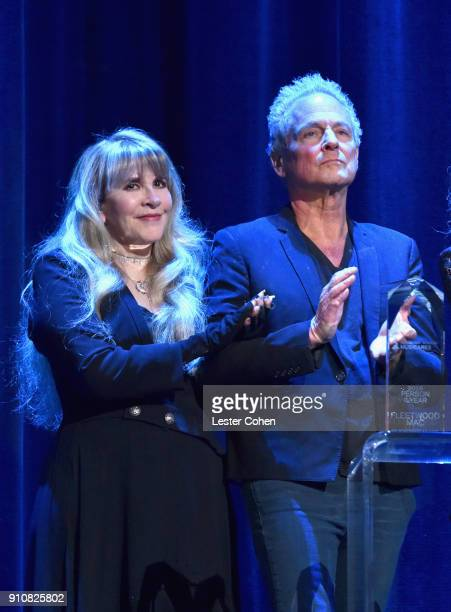 Honorees Stevie Nicks and Lindsey Buckingham of music group Fleetwood Mac accept the MusiCares Person of the Year award onstage during MusiCares...