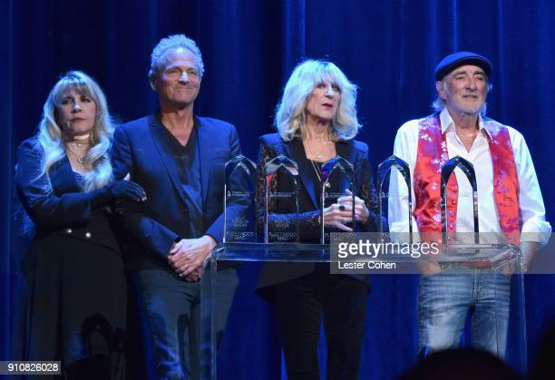 Honorees Stevie Nicks, Lindsey Buckingham, Christine McVie, and John McVie of Fleetwood Mac accept the MusiCares Person of the Year award onstage...