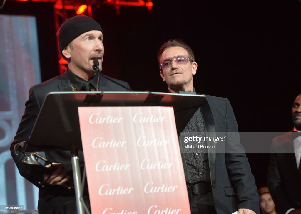 Honorees The Edge and Bono accept the Sonny Bono Visionary award onstage during the 25th annual Palm Springs International Film Festival awards gala at Palm Springs Convention Center on January 4, 2014 in Palm Springs, California.