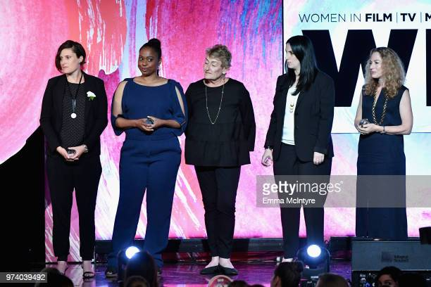 Honorees Victoria Alonso and crew of 'Black Panther' accept The Lexus Beacon Award onstage during the Women In Film 2018 Crystal Lucy Awards...