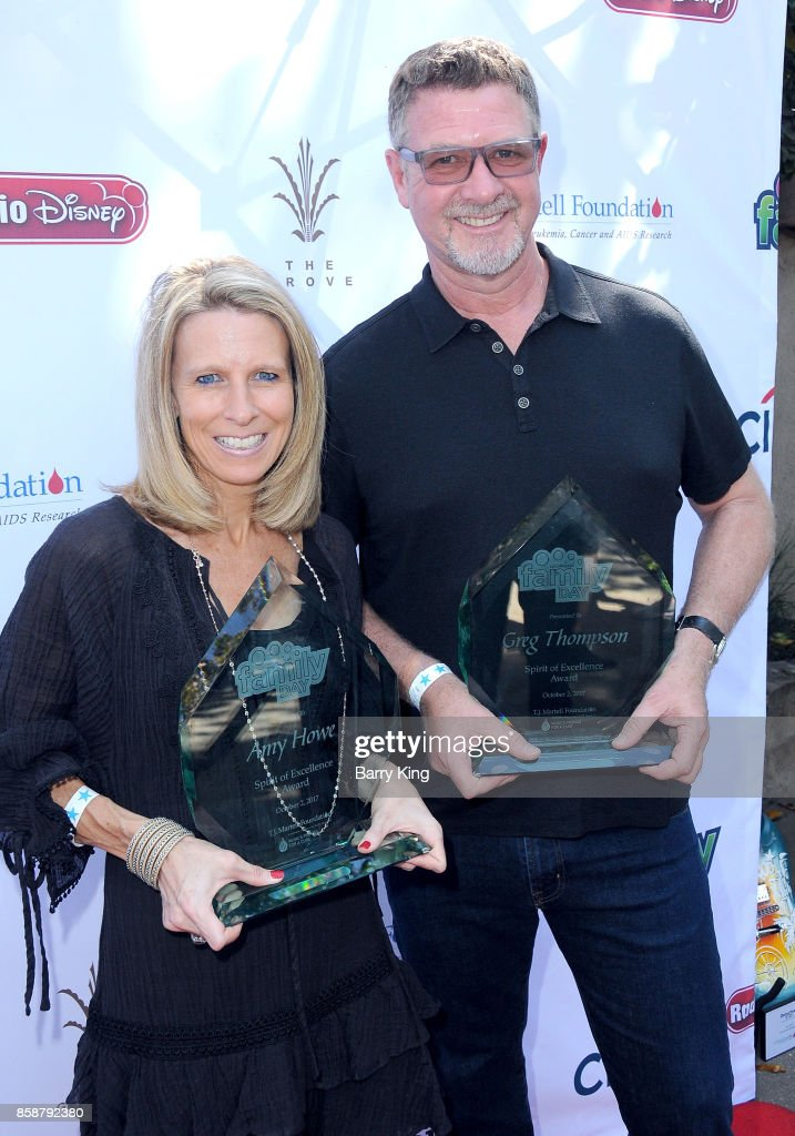 Honoree/ticketmaster COO Amy Howe and honoree/Record executive Greg Thompson attend T.J. Martell Foundation Family Day at The Grove on October 7, 2017 in Los Angeles, California.