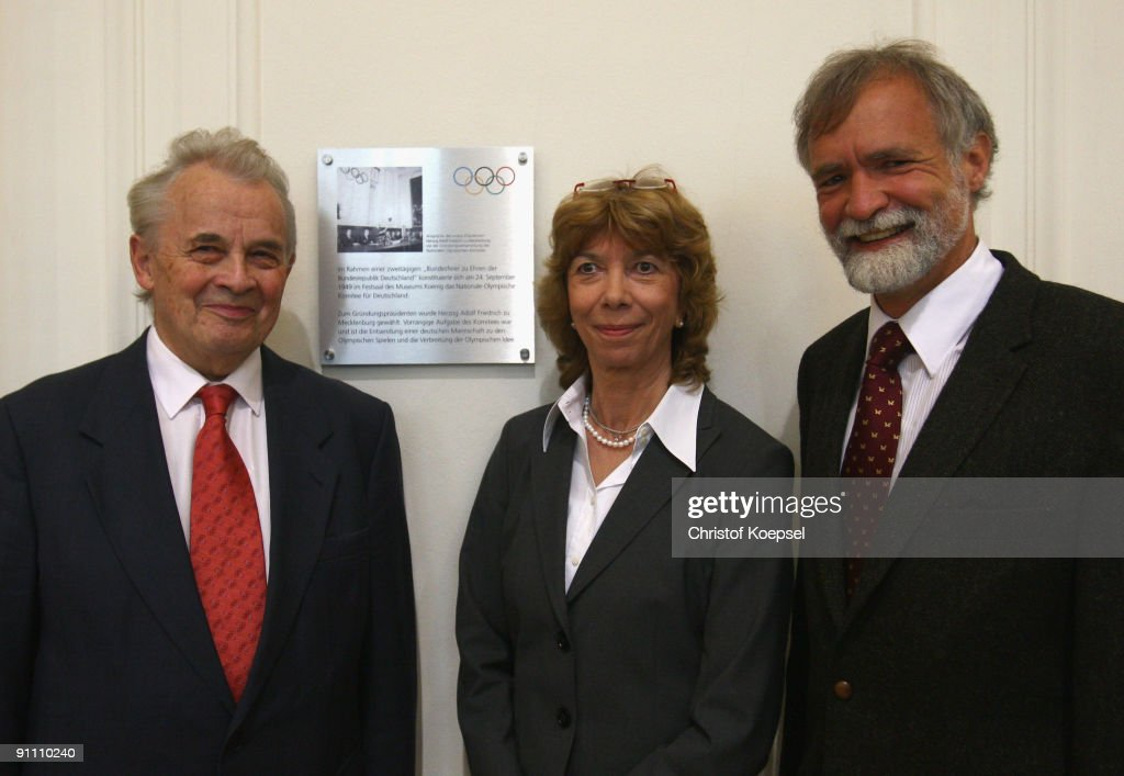 Honory member of German Olympic Sports Federation Walther Troeger, German Olympic Sports Federation vice president of culture and Olympic education doctor Gudrun Doll-Tepper and curator Wolfgang Waegele pose in front of the memorial plaque during the 60th German National Olympic Committee anniversary at museum Koenig on September 24, 2009 in Bonn, Germany.