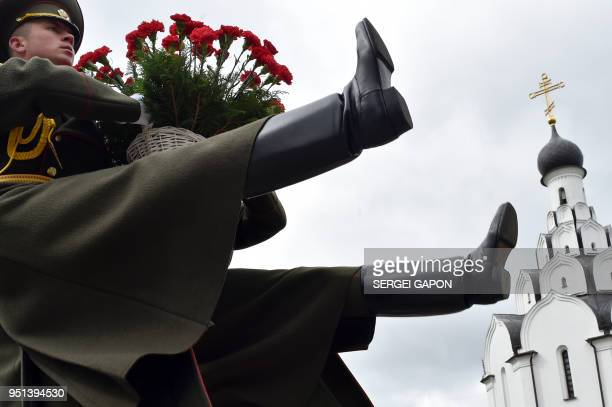 TOPSHOT Honour guard soldiers lay flowers at the Chernobyl victims' memorial in Minsk on April 26 2018 The world marks 32 years since the world's...