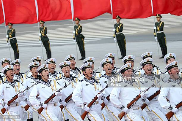 Honour guard troops march during a welcome ceremony for Australia's Prime Minister Julia Gillard outside the Great Hall of the People on April 9 2013...