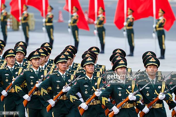 Honour guard troops march during a welcome ceremony for Vietnamese Prime Minister Nguyen Xuan Phuc outside the Great Hall of the People on September...