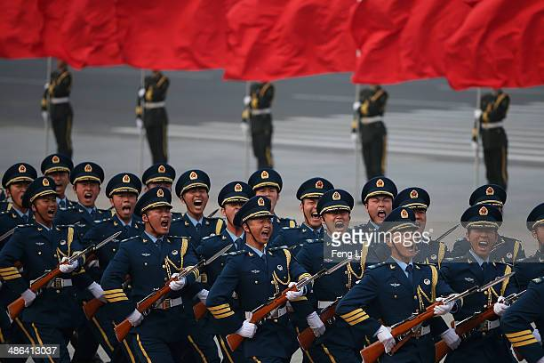 Honour guard troops march during a welcoming ceremony for Denmark's Queen Margrethe II outside the Great Hall of the People on April 24 2014 in...