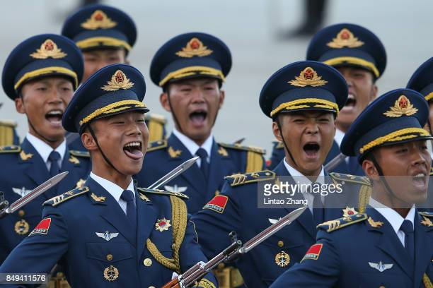 Honour guard troops march during a welcoming ceremony for Singapore Prime Minister Lee Hsien Loong outside the Great Hall of the People on September...