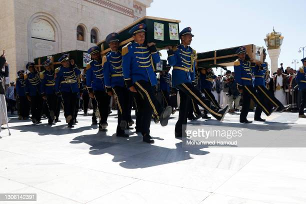 Honour guards carry coffins of Houthi fighters killed in recent escalated fighting between the Houthis and forces of the government over the control...