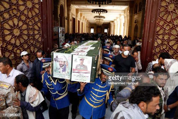 Honour guards carry coffins of Houthi fighters killed in the ongoing fighting between the Houthis and forces of the government over the control of...