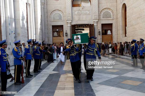 Honour guards carry coffins of Houthi fighters who were killed in recent confrontations against forces of the government in Yemen's gas-rich province...