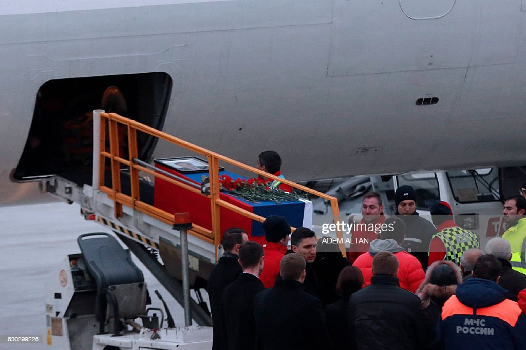 Honour guards load the coffin of Andrei Karlov, Moscow's slain ambassador, onto the plane heading to Moscow, following a ceremony on the tarmac of Esenboga airport in Ankara, on December 20, 2016. Veteran diplomat Andrei Karlov was shot nine times in the back by an off-duty Turkish policeman at the opening of an exhibition of Russian photography on December 19, 2016. The brazen killing stunned Ankara and Moscow, which have rowed repeatedly over the Syria conflict but in recent weeks have begun cooperating closely on the evacuations from war-wrecked Aleppo. / AFP / ADEM