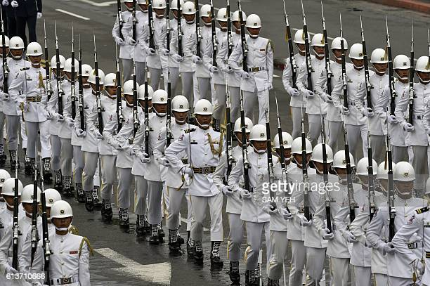 Honour guards march during National Day celebrations in front of the Presidential Palace in Taipei on October 10 2016 Taiwanese President Tsai Ingwen...