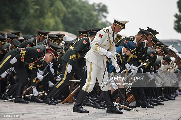 Honour guards pick up their weapon before the welcoming ceremony of Peruvian President outside the Great Hall of the People on September 13 2016 in...
